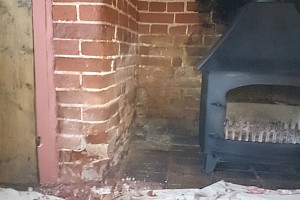 Brickwork restoration carried out on fireplace.